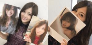 白石麻衣が直筆サイン入りの写真集の写真を持っている画像